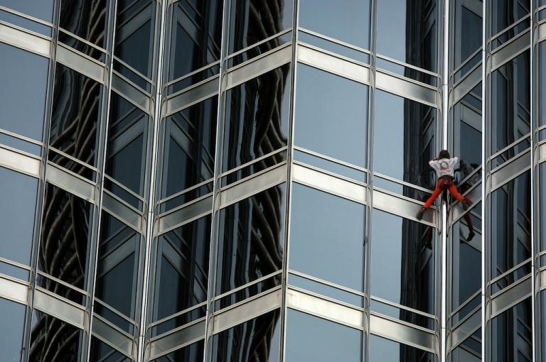<p>French climber Alain Robert scales the world's tallest tower, Burj Khalifa, in Dubai on March 28, 2011.</p>