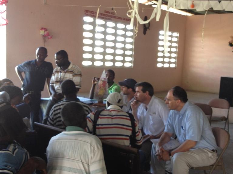 <p>Alan Khazei, Jacob Kushner and I listen to Haitians talking about American aid in Coupon, Haiti.</p>