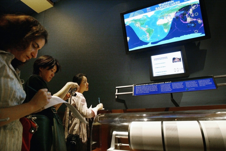 <p>Reporters take notes at the new earthquake monitoring station June 23, 2004 at the Museum of Natural History in New York City. On exhibit in the Gottesman Hall of the Planet Earth, the earthquake station features a three-drum seismograph that constantly monitors and records the shaking of the ground as it is happening in Fairbanks, Alaska, Tuscon, Arizona and Nagano, Japan. The exhibit also features a color screen on which a map of the world alternates show real-time seismic activity.</p>