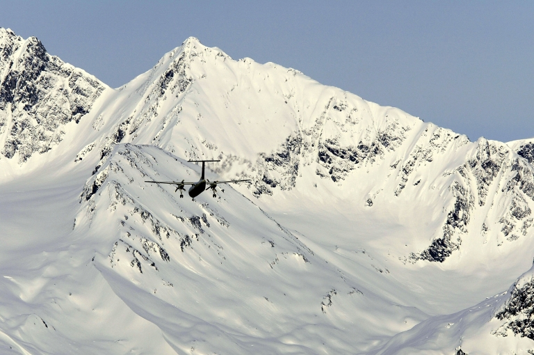 <p>An airplane prepares to land against a backdrop of frozen mountains April 1, 2004 in Valdez, Alaska.</p>