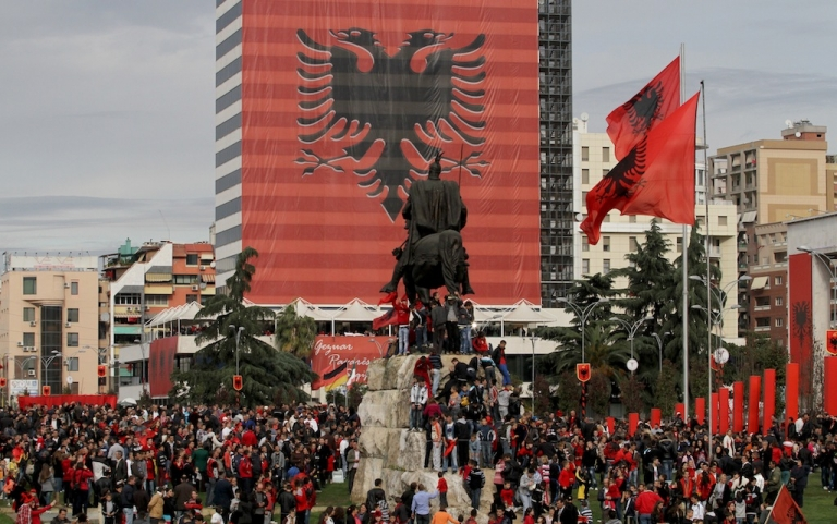 <p>Albanians on Tirana's main square mark the 100th anniversary of independence from the Ottoman Empire last year.</p>