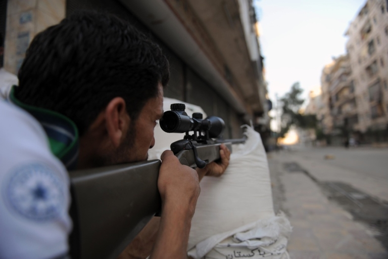 <p>A fighter from the Syrian opposition aims fire during clashes with forces loyal to President Bashar al-Assad, in the center of Syria's restive northern city of Aleppo on July 25, 2012.</p>