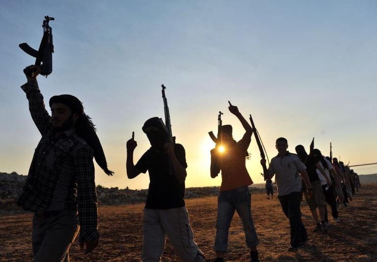 <p>Members of Jihadist group Hamza Abdualmuttalib train near Aleppo on July 19, 2012.</p>