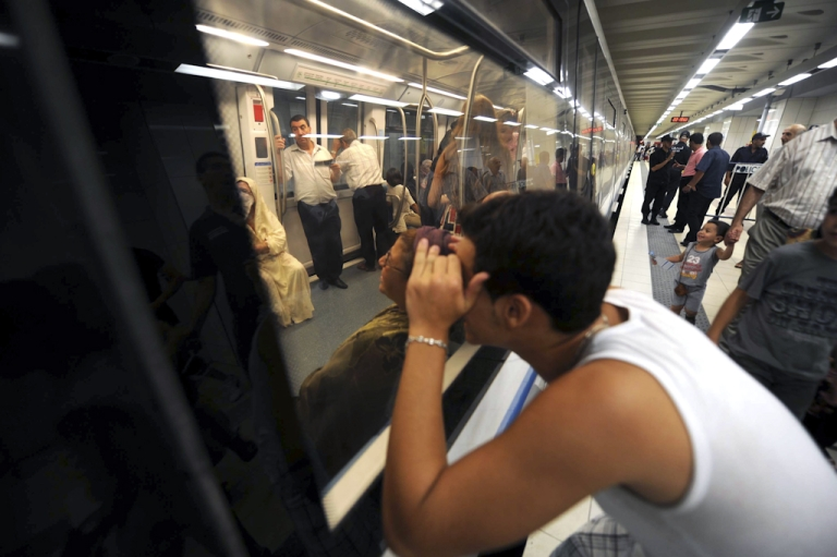 <p>Would be passengers enter a metro carriage in La Grande Poste station in Algiers' new underground network on August 18, 2011 during an informative evening orgainised by the the transport authorities to familiarise commuters with the new line.</p>