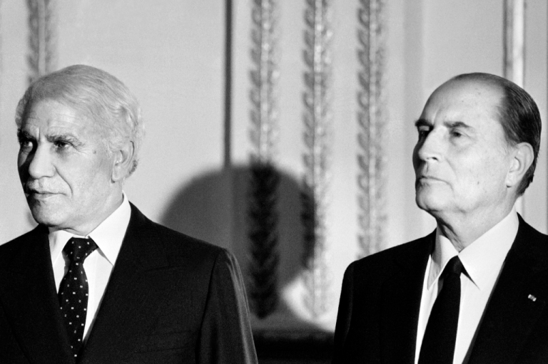 <p>Algerian President Chadli Bendjedid (L) attends the dinner reception with his French counterpart François Mitterrand at the Elysee Palace in Paris, during his official visit on November 8, 1983 in France.</p>