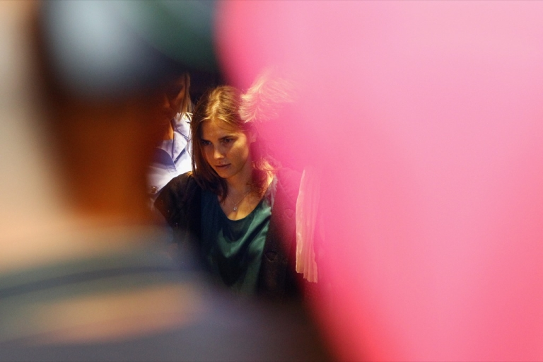 <p>Amanda Knox is escorted to her appeal hearing at Perugia's Court of Appeal on October 3, 2011 in Perugia, Italy.</p>