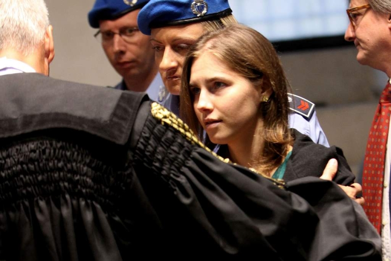 <p>PERUGIA, ITALY - OCTOBER 03:  Amanda Knox arrives  at Perugia's Court of Appeal the day of the verdict in Amanda Knox and Raffaele Sollecito's appeal of their murder convictions on October 3, 2011 in Perugia, Italy. American student Amanda Knox and her Italian ex-boyfriend Raffaele Sollecito were convicted in 2009 of killing their British roommate Meredith Kercher in Perugia, Italy in 2007. The jury in their appeal is expected to retire to consider their verdict later today. They have served nearly four years in jail after being sentenced to 26 and 25 years respectively.</p>