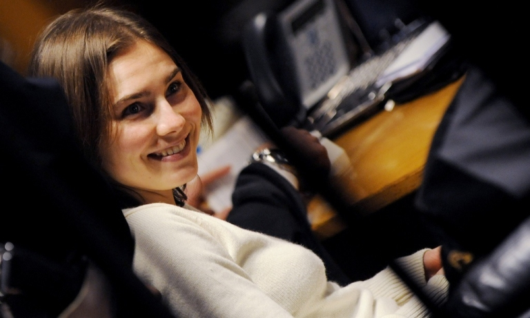 <p>Amanda Knox smiles during her appeal trial in Perugia on Jan. 22, 2011.</p>
