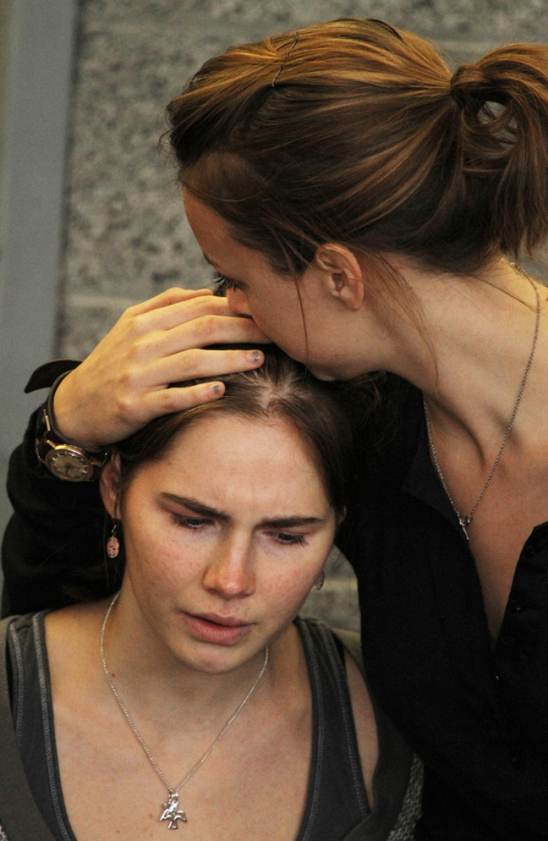 <p>Amanda Knox is comforted by her sister, Deanna Knox, during a news conference shortly after her arrival at Seattle-Tacoma International Airport in October. Knox has sold the rights to her memoir to Harper Collins for $4 million.</p>
