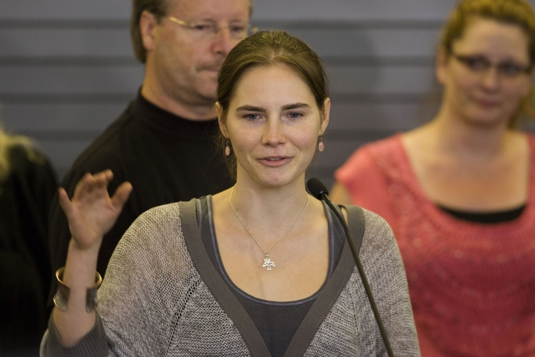 <p>Amanda Knox waves to supporters as she makes her first appearance at SeaTac Airport after arriving in Seattle following her release from prison in Italy on October 4, 2011. Knox arrived home a day after she was acquitted of murder and sexual assault charges and freed from jail in Italy.</p>