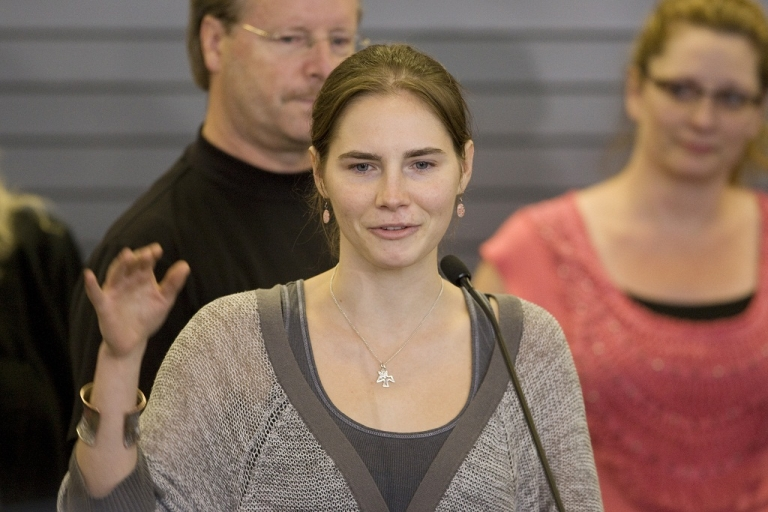 <p>Amanda Knox waves to supporters as she makes her first appearance at SeaTac Airport after arriving in Seattle following her release from prison in Italy on October 4, 2011. She told CBS in a letter that she was sexually harassed in prison.</p>