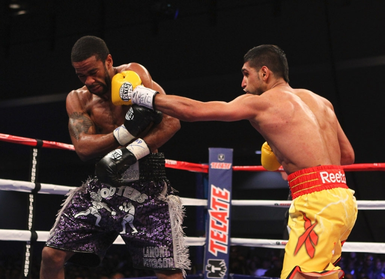 <p>Amir Khan Lamont Peterson during their WBA Super Lightweight and IBF Junior Welterweight title fight at Washington Convention Center on December 10, 2011 in Washington, DC.</p>