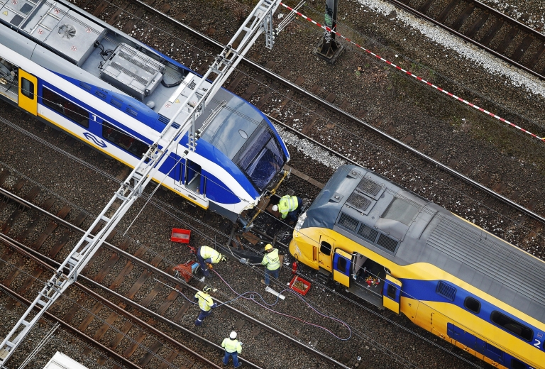 <p>This aerial photo released today shows two trains which collided Saturday in Amsterdam.</p>