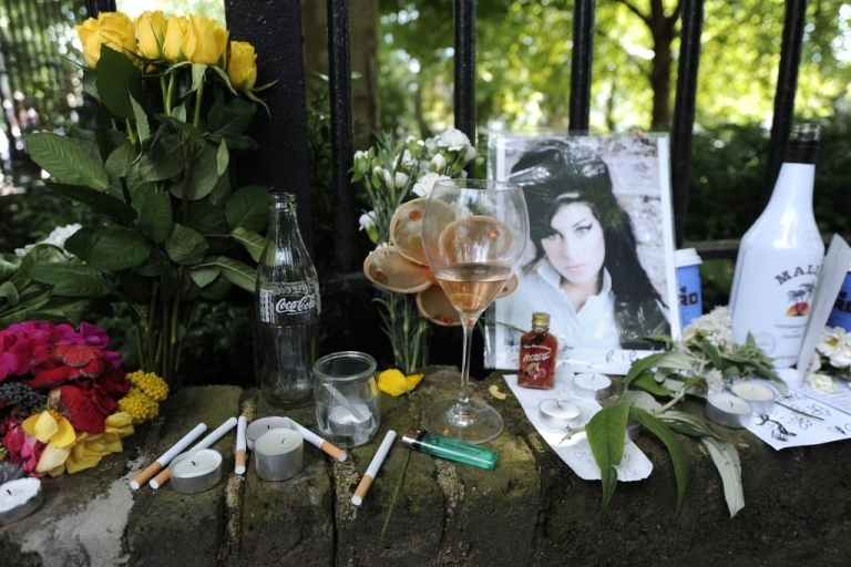 <p>Fans leave behind flowers and messages as well as cigarettes and alcohol to remember the pop star Amy Winehouse, who struggled with drink and drugs, and was found dead at her flat in North London on July 23, 2011.</p>