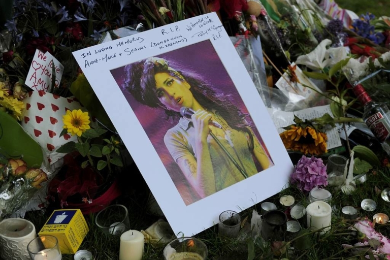 <p>Fans bought the late Amy Winehouse's CDs and set up a large memorial near her Camden Square home in London where her body was found on July 23, 2011.</p>