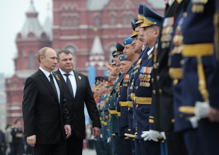 <p>President Vladimir Putin and then Defense Minister Anatoly Serdyukov inspect the troops in Moscow in May 2012. Putin has fired Serdyukov over a corruption scandal at the Defense Ministry.</p>
