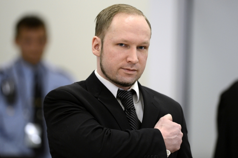 <p>Self confessed mass murderer and right-wing extremist Anders Behring Breivik places a clenched fist on his heart in a salute as he arrive on day three in room 250 at the central court in Oslo on April 18, 2012. Anders Behring Breivik, who killed 77 people in Norway last July, took the stand again on April 19, 2012, stating that he originally planned to detonate three bombs.</p>