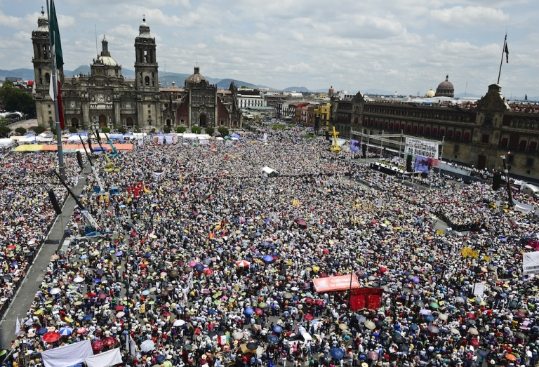 <p>Thousands of supporters of leftist politician Andres Manuel Lopez Obrador attend a rally in Mexico City's Zocalo Square today.</p>