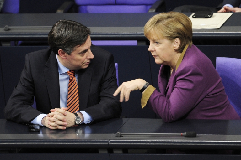 <p>German Chancellor Angela Merkel (R) speaks with Lower Saxony's State Premier David McAllister at a session at a meeting of Germany's lower house of parliament on February 27, 2012 in Berlin.</p>