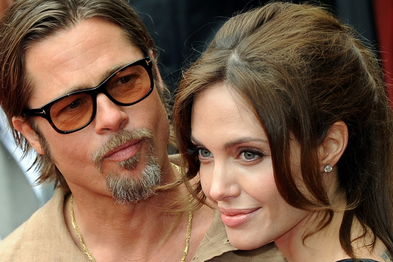 <p>Actors Brad Pitt and Angelina Jolie in Los Angeles on May 22, 2011.</p>