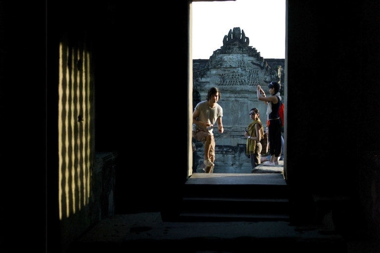 <p>Tourists visit the world heritage Angkor Wat temple during sunrise in Siem Reap province, some 300 kilometers northwest of Phnom Penh on July 14, 2012. Built by King Suryavarman II in the 12th century, Angkor Wat is considered the largest Khmer temple complex in the world.</p>