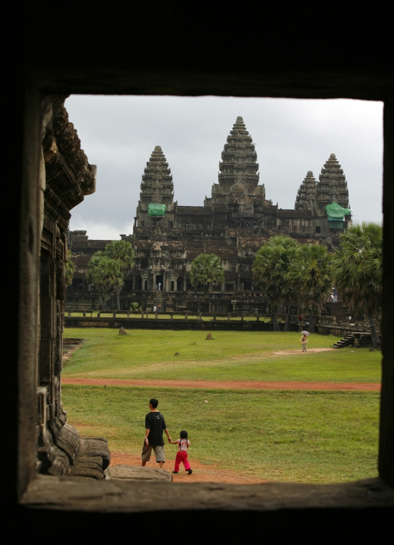 <p>Tourists walk on the grounds of the Angkor Wat temple in Siem Reap, Cambodia. Construction has begun on a replica in India that will be even taller than the original, which was built in the 12th century and is currently the world's tallest religious structure.</p>