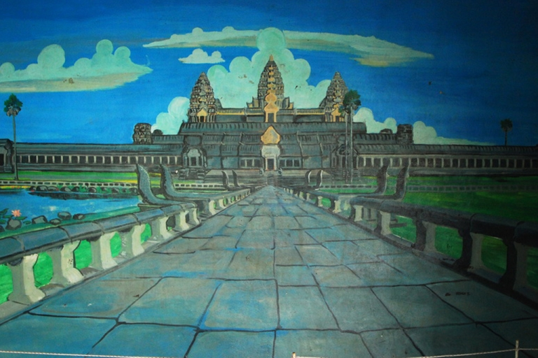 <p>Garish murals grace the walls of Ta Mok's home in Anlong Veng, including this painting of Angkor Wat.</p>