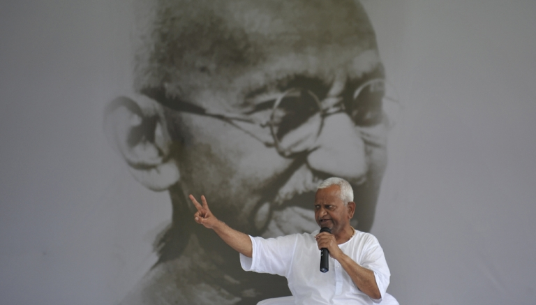 <p>Anti-corruption activist Anna Hazare gestures during a rally at Ram Lila grounds in New Delhi on August 23, 2011. Indian activist Hazare said he was ready 'to die' for India as the government called an all-party meeting to try to break its damaging standoff with the anti-corruption campaigner. Hazare's hunger strike has captured the public imagination in India, triggering huge protests and boxing Prime Minister Manmohan Singh's graft-tainted government into a tight political corner.</p>