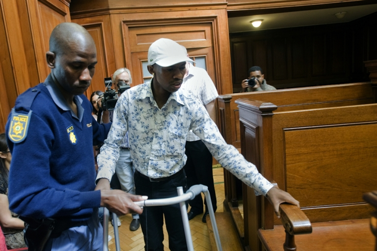 <p>Xolile Mngeni, the man accused of killing Swedish honeymooner Anni Dewani, walks with a Zimer frame as he arrives into the Cape Town's High Court on November 19, 2012, to hear judgment. Mngeni has suffered from a brain tumor, which was removed before the case started. Mngeni claimed innocence in the November 2010 killing but admitted to his palm print having been found on the car in which Dewani's lifeless body was found in a poor Cape Town township. State prosecutor told Mngeni that his claims of not being at the murder scene were lies, as witnesses had testified otherwise and claimed that he had pulled the trigger. The 25-year-old had also been found in possession of items taken from Dewani and the honeymooning couple's taxi driver and had pointed out key details of the slaying to police after his arrest, prosecutor said.</p>