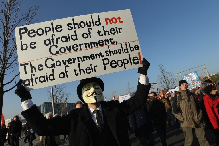 <p>A man wearing an Anonymous mask joins demonstors protesting against the world financial system during a march on November 12, 2011 in Berlin, Germany. Inspired by the 'Occupy Wall Street' protests in the USA, similar protests have been taking place across Germany, especially in Berlin and Frankfurt, for weeks.</p>
