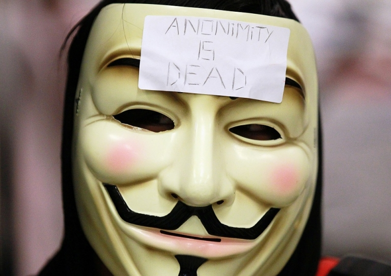 <p>SAN FRANCISCO, CA - AUGUST 15:  A demonstrator wears a mask during a protest inside the Bay Area Rapid Transit (BART) Civic Center station on August 15, 2011 in San Francisco, California.  The hacker group