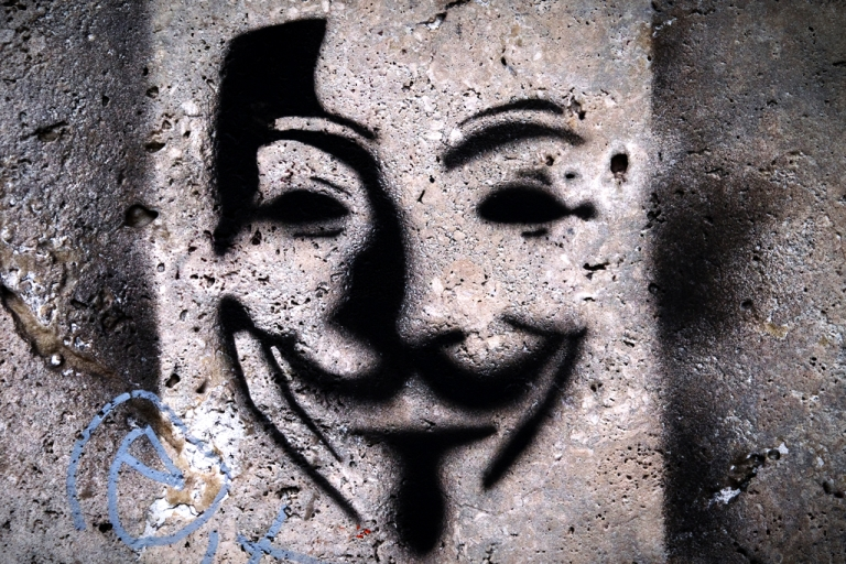 <p>Picture of a painting on a wall representing Anonymous Guy Fawkes mask taken in a street of Paris, on April 24, 2012.</p>