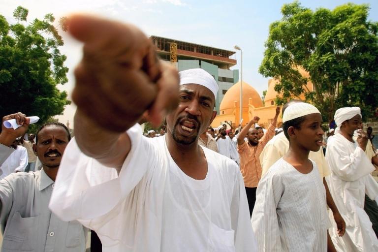 <p>Sudanese men shout slogans during a protest in Khartoum on Sept. 14, 2012.</p>
