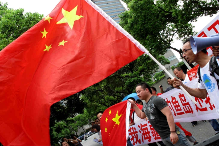 <p>Protesters take part in an anti-Japanese protest outside the Japanese consulate in Shanghai following the arrest of a group of pro-China activists who landed on a disputed archipelago known as Diaoyu in China and Senkaku in Japan.</p>