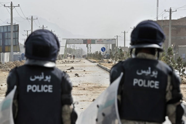 <p>Afghan policemen walk towards the crowd on Jalalabad Road during an anti-US protest in Kabul on September 17, 2012. Hundreds of Afghans staged a violent protest in Kabul on Monday against an American film mocking the Prophet Mohammed, throwing stones at a US base, torching cars and shouting 'Death to America', police said.</p>