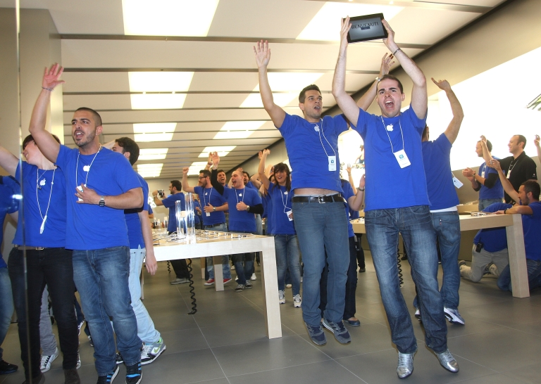 <p>Apple Store employees cheer during the grand opening of the Apple Store Porta di Roma on April 21 in Rome.</p>