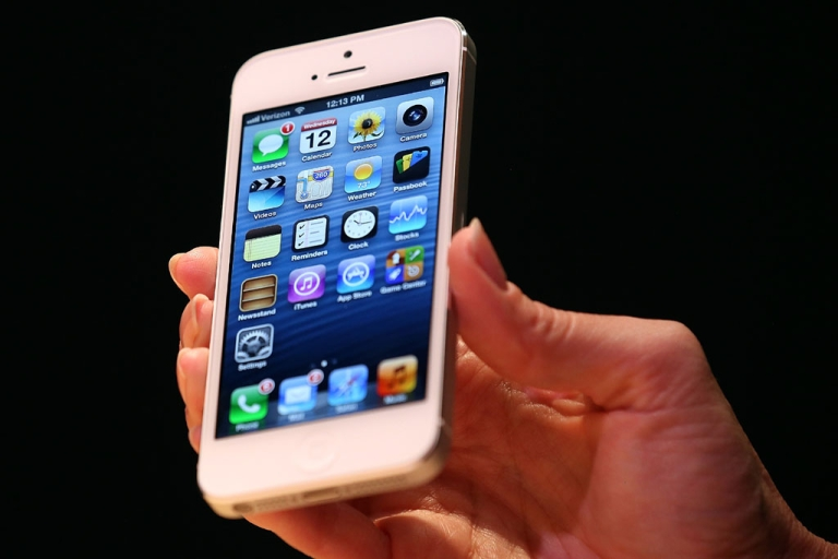 <p>The new iPhone 5 is displayed during an Apple special event at the Yerba Buena Center for the Arts on Sept. 12, 2012 in San Francisco.</p>