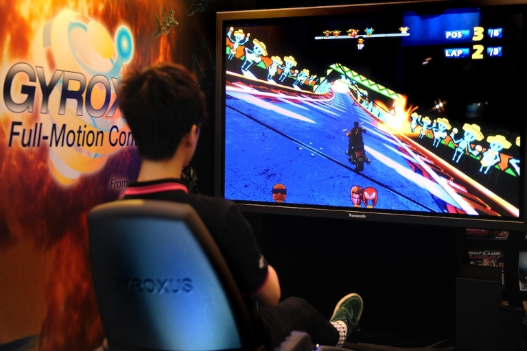 <p>A visitor plays a full-motion controlled game during the Hong Kong Electronics Fair on April 14, 2012.</p>