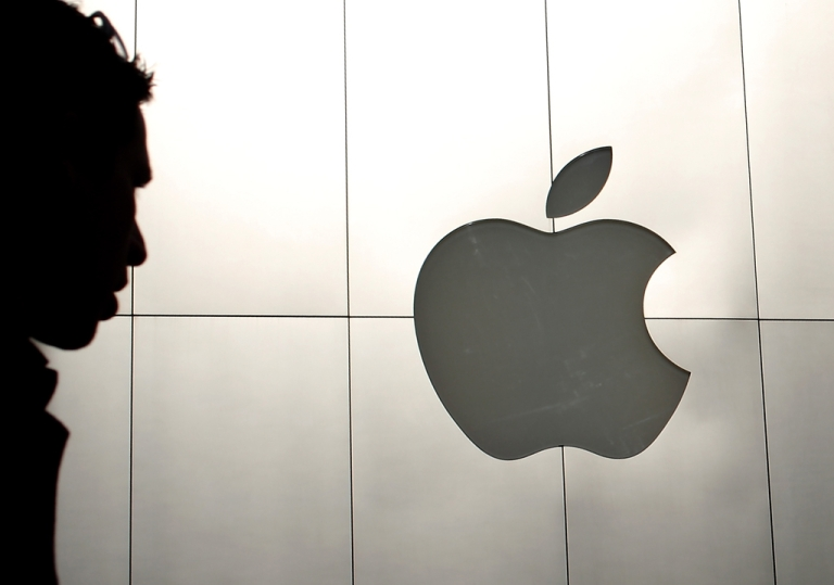<p>A pedestrian walks by an Apple Store in San Francisco, California.  Apple's value topped $600 billion on Tuesday.</p>