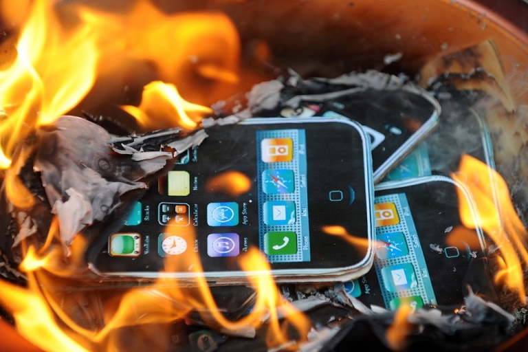 <p>Protestors from SACOM (Students and Scholars Against Corporate Misbehaviour) burn effigies of Apple products during a demonstration near the offices of Foxconn in Hong Kong on May 25, 2010. Harsh working conditions and child labor where its product are made put Apple under fire earlier this year.</p>