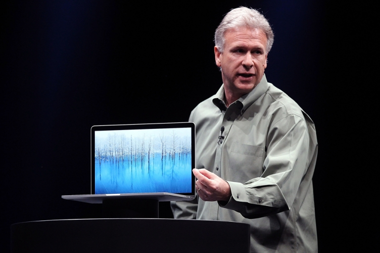 <p>Apple Senior Vice President of Worldwide product marketing Phil Schiller announces the new MacBook Pro during the keynote address during the Apple 2012 World Wide Developers Conference (WWDC) at Moscone West on June 11, 2012 in San Francisco, California. According to reports Apple is expected to unveil a slew of new hardware and software updates at the company's annual developer conference which runs through June 15.</p>