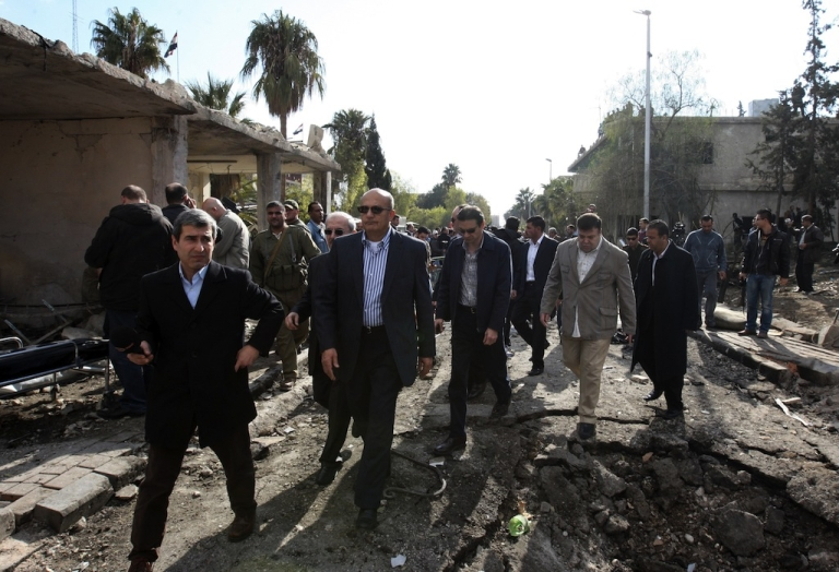 <p>Deputy Arab League Seretary General Samir Seif al-Yazal inspects with a group of Arab observers the site of a suicide attack, which targeted the Syrian General Intelligence headquarters, in Damascus on December 23, 2011.</p>