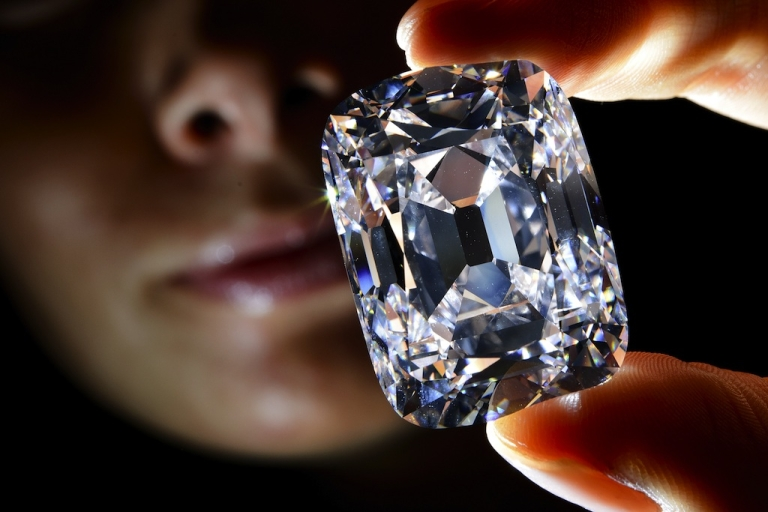 <p>This picture taken on October 3, 2012 shows a model holding the Archduke Joseph diamond during a Christie's auction preview in Geneva.</p>