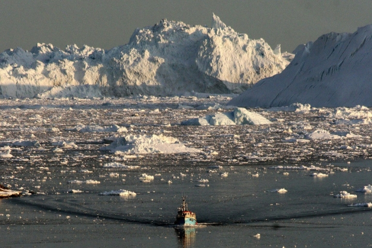 <p>A boat skims through the ice of Greenland's Ilulissat glacier, one of the biggest and most active in the world. The rate of Illulissat's melting, as well as other Arctic glaciers, has experts and indigenous peoples worried about what the future may hold for the ecosystems of the Arctic.</p>