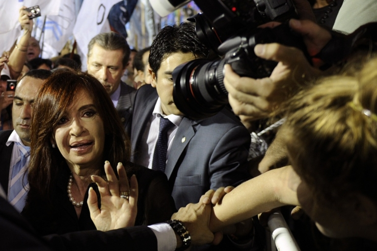 <p>Argentine President Cristina Kirchner greets supporters during a political rally at Huracan stadium in Buenos Aires on March 11, 2010 where almost 20,000 supporters supported her reelection in the upcoming elections.</p>