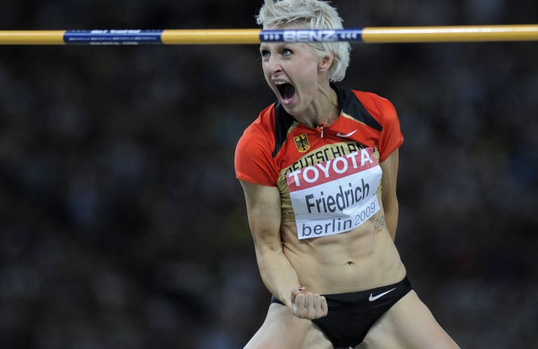 <p>Germany's Ariane Friedrich celebrates after taking the third place in the women's high jump final of the 2009 IAAF Athletics World Championships on August 20, 2009 in Berlin.</p>