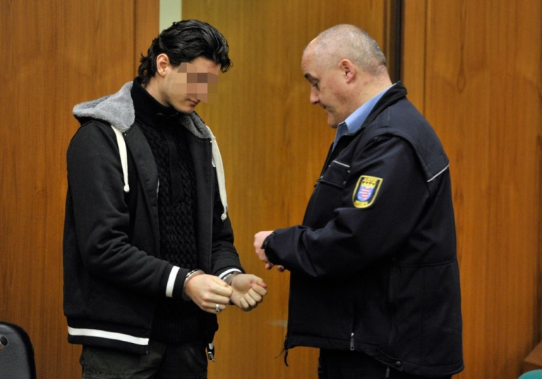 <p>A justice officer uncuffs Arid Uka (L) as he arrives at court on Jan. 9, 2012 in Frankfurt, western Germany.</p>