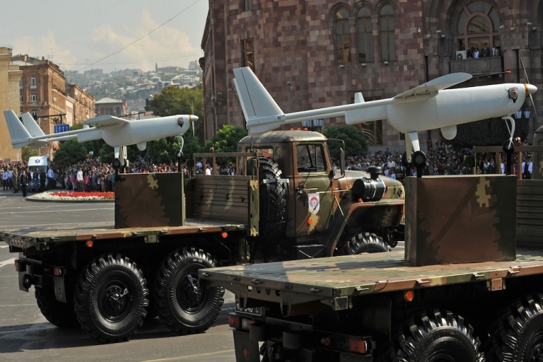 <p>Armenian-built drones atop their launchers roll during a military parade in 2011. Armenia and Azerbaijan are both flexing their military muscles, flying drones over the border between them and fueling worries that the exercises could lead to all-out war.</p>