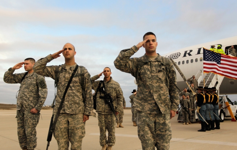 <p>U.S. Army soldiers from the 3rd Brigade, 1st Cavalry Division salute on Dec 16 as they arrive at their home base,  Fort Hood, Texas after being part of one of the last American combat units to exit from Iraq.</p>
