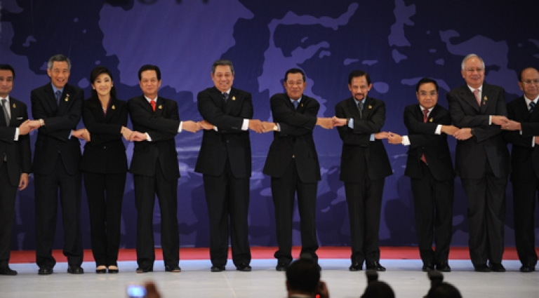 <p>Believe it or not, this is serious business.  Shown here linking hands for a publicity shot during the opening of the 19th summit of the Association of South East Asian Nations (ASEAN), the leaders and representatives of ASEAN may be poised to take on greater importance as Obama reboots America's Asian agenda.</p>